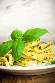 foto of pesto sauce  - Cooked homemade tagliatelle pasta with green pesto sauce - JPG