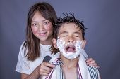 pic of razor  - A funny image of a boy showing his fear because sister has a razor. ** Note: Shallow depth of field - JPG