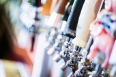 foto of draft  - Close up of beer lines for draft beer in restaurant. ** Note: Shallow depth of field - JPG