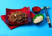 foto of stir fry  - Vietnamese beef stir fry served on a blue background - JPG