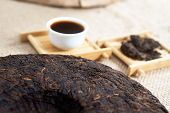 picture of briquette  - Chinese Puer tea pressed into rounded briquettes - JPG