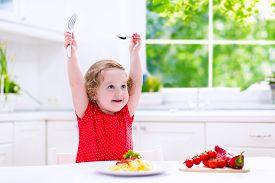stock photo of noodles  - Kids eat pasta - JPG
