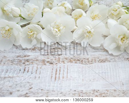 White english dogwood flowers on the rustic rough painted background