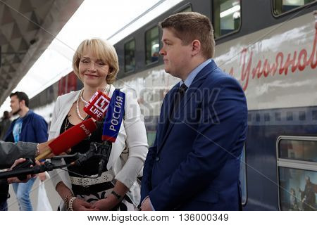 ST. PETERSBURG, RUSSIA - MAY 28, 2016: Deputy director of JSC FPK Stanislav Zotin (right) and President of the Mikhail Ulyanov's foundation Elena Ulyanova talk with press at the double-decker train