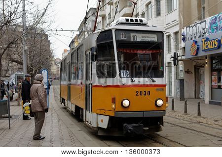 SOFIA, BULGARIA - MARCH 6, 2016: People at the tram in the city center. The tramway system in Sofia was created in 1901, and now is the only tramway system in Bulgaria