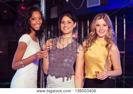 Pretty girls having shots in a nightclub