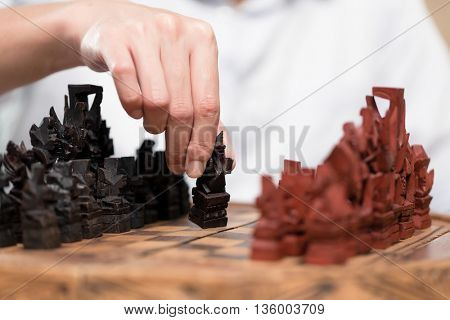 Man playing Asian chess game