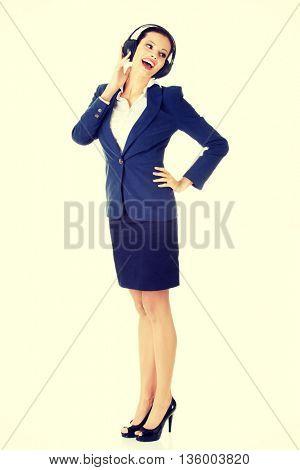Attractive businesswoman with headphones
