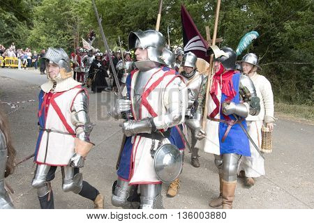 Tewkesbury, UK-July 17, 2015: Knights in armour marching toward battle on 17 July 2015 at Tewkesbury Medieval Festival