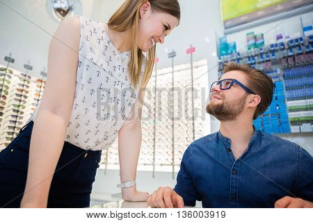 Customer Flirting With Shop Assistant