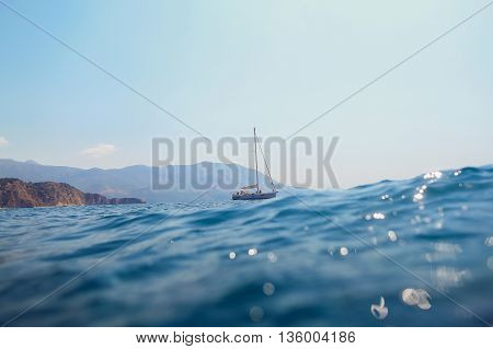 Yacht Sail In Sea With Picturesque View