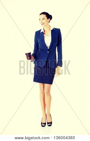 Business woman with cartoon mug
