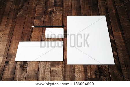 Blank stationery set. Blank corporate identity template on vintage wooden table background. Blank letterhead business cards envelope and pen. Mock-up for branding identity. Responsive design template.