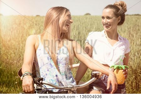 trendy twin girls making a bike tour. summerfeeling.