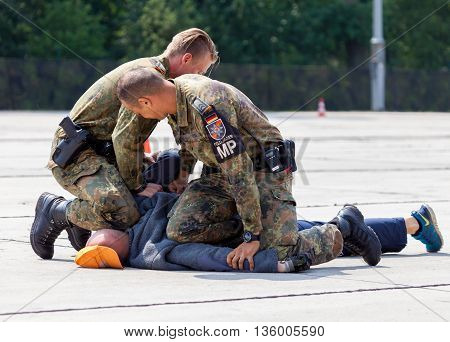 BURG / GERMANY - JUNE 25 2016: german military police bodyguards defeats an assassin on an exercise in burg / germany at june 25 2016