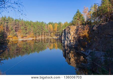 Fragment Of The Lake Shore With Stone In Autumn Forest