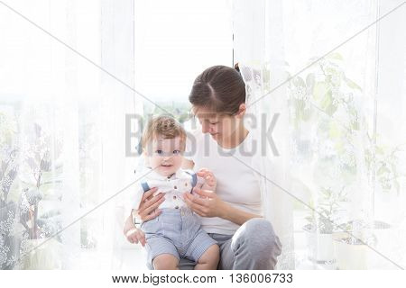 Happy Family Mother Playing With Newborn Baby