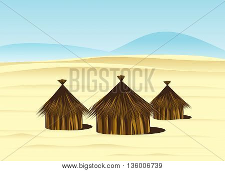 desert. Tribal round house, the dunes against the blue sky and mountains