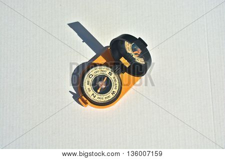 Magnetic compass. Compass - navigation instrument on a white background.