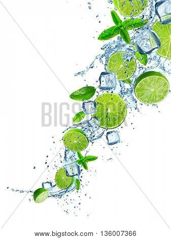 Fresh limes in water splash over white background