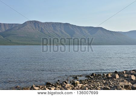 Summer landscape North of the lake. Lake in the Putorana plateau Sunny day.