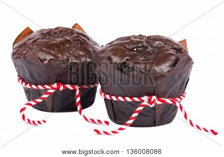 Close up chocolate muffin isolated on white background