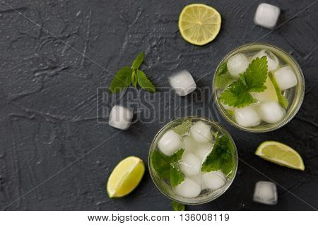 Refreshing summer cocktail with lime and mint. Mojito cocktail selective focus