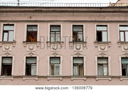 Facade of classical building with rows of windows.