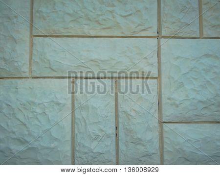 brick wall beige made of different bricks