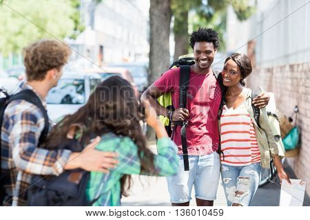 Woman taking photo of her friends outdoors