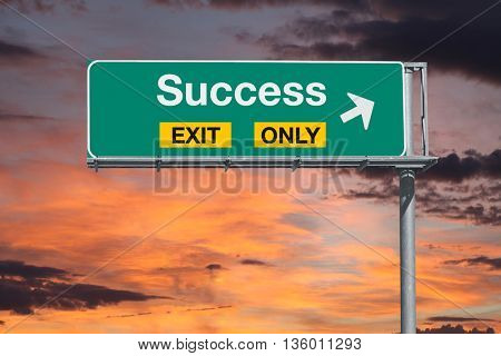 Success exit only highway sign with sunrise sky.