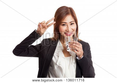 Young Asian Woman Show Victory Sign With A Glass Of Drinking Water