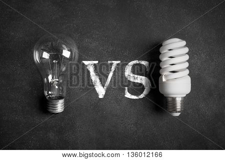 Electric bulbs on the green chalkboard (old and modern lamp). Image is describing the problem of using old or modern type of lamp