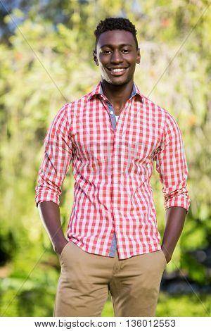 Happy man posing at park