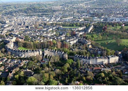 View of the City of Bath from a hot air balloon high overhead showing the extraordinary architecture and green spaces the palce has to offer.