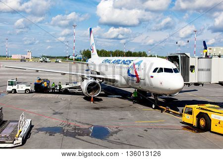 RUSSIA, SAINT-PETERSBURG, INTERNATIONAL AIRPORT PULKOVO - 17 JUNE 2016: Aircraft of Ural Airlines aircompany waiting for boarding passengers