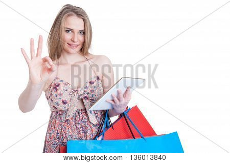 Joyful Young Woman With Modern Tablet Doing Ok Gesture