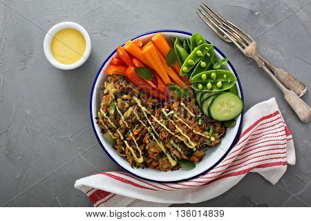 Potato carrot and spinach hushbrown fritters with fresh vegetables for breakfast