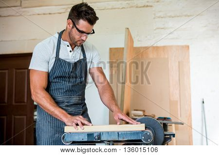 Carpenter working on his craft in his workshop