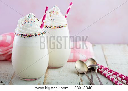 Vanilla funfetti milkshake with whipped cream and sprinkles