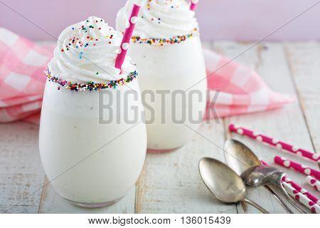 Vanilla funfetti milkshake with whipped cream and sprinkles