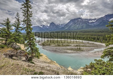 Athabasca River flowing through the Rocky Mountains - Jasper National Park Alberta Canada