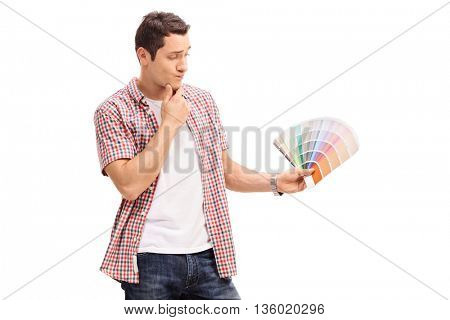 Man looking at a color swatch and choosing color isolated on white background
