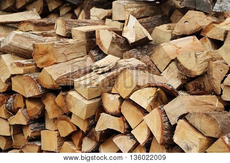 Freshly Chopped firewood stacked into a pile