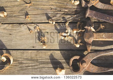 Rusty set of old hand tools on a wooden background. Vintage photo