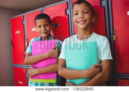 Boys standing in front of locker at school