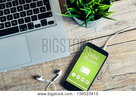 Online shopping website in a mobile phone screen. E-commerce concept. Top view.