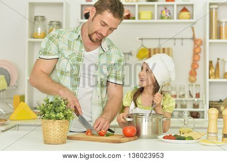 portrait of happy father and daughter with food