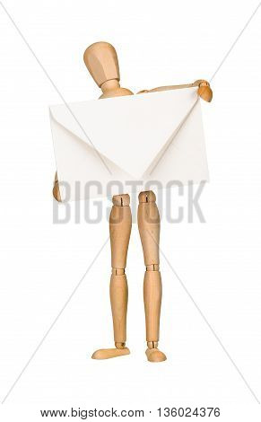 Wooden model dummy holding envelope, isolated on white. Mail concept.