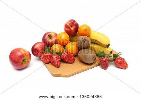 fresh ripe fruit on a cutting board. white background - horizontal photo.